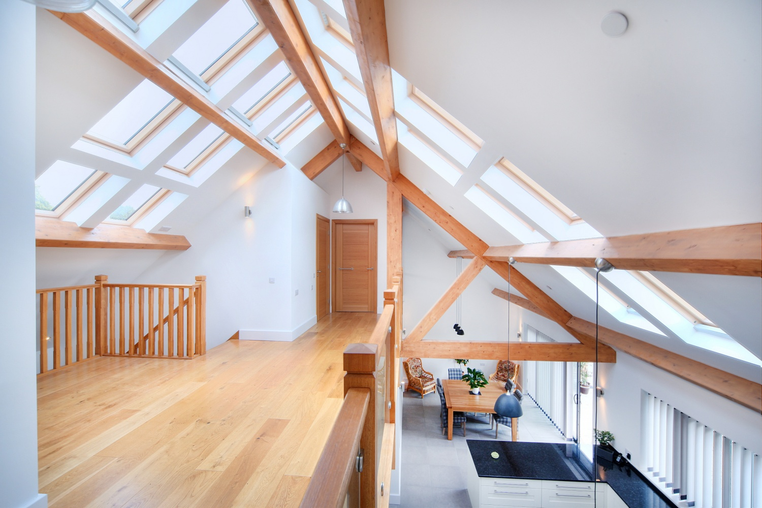 looking over the balcony in a new build in Sheffield designed by Architect Chris Capps