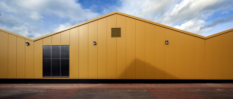 yellow building, orange building, metal cladding, light well
