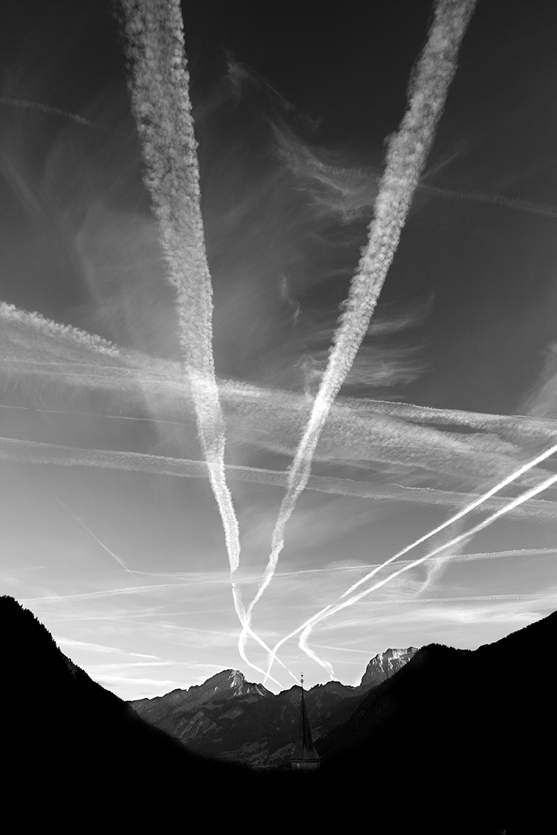 plane trail, black and white, vertical landscape