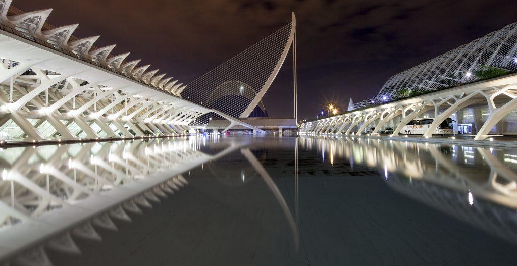 a reflection on the man made lake at Ciudad de las Artes y las Ciencias in Valencia Spain at night