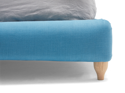 Dozer upholstered buttoned bed
