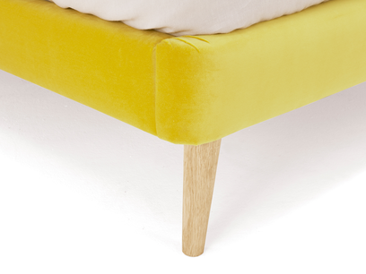 Upholstered Napper bed with solid oak legs