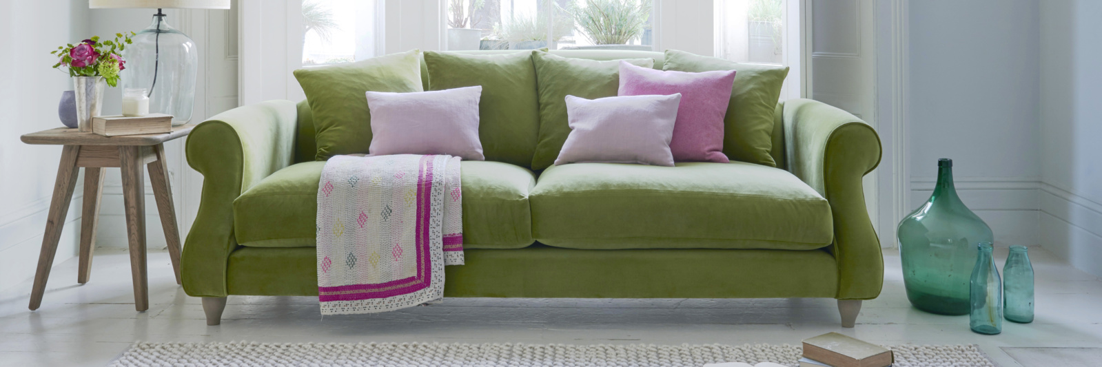 Sloucher French-style green sofa