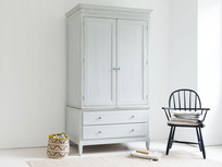 Flutterby wardrobe in vintage white and inky blue interior