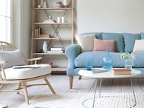Burbler chair and Crumpet comfy sofa with tall legs
