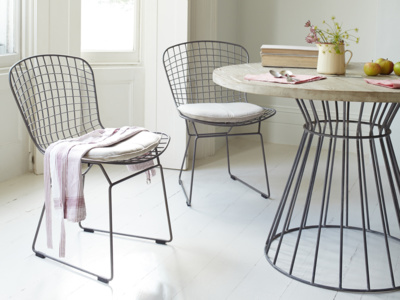 Metal wire Hamburger kitchen chairs in an industrial style with linen seat pads