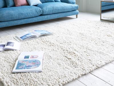 Shaggy rug is a handmade knitted floor rug