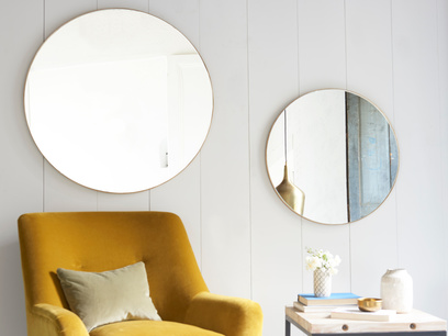 Large round brass Real Deal mirror