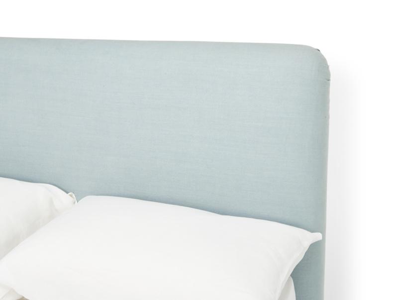 Luxury upholstered headboard on modern Ruffle bed