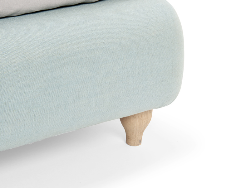 Contemporary Ruffle bed has solid oak legs with lovely weathered finish