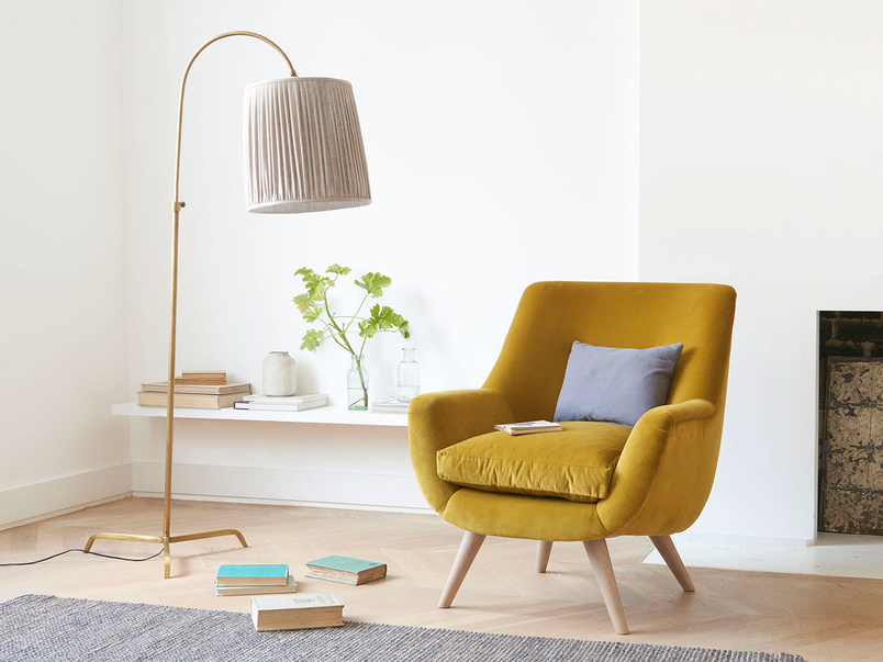Brass Slam Dunk curved floor lamp with tripod legs