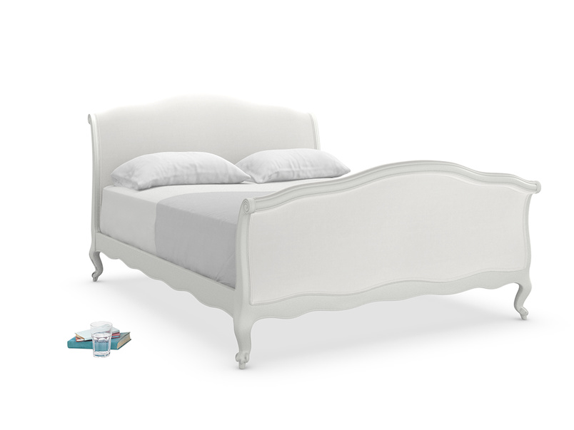 Antoinette bed painted in scuffed grey is an elegant French style sleigh bed upholstered in a choice of fabrics