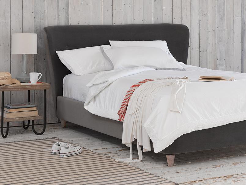 Retro style luxury Smoke upholstered bed handmade in Britain