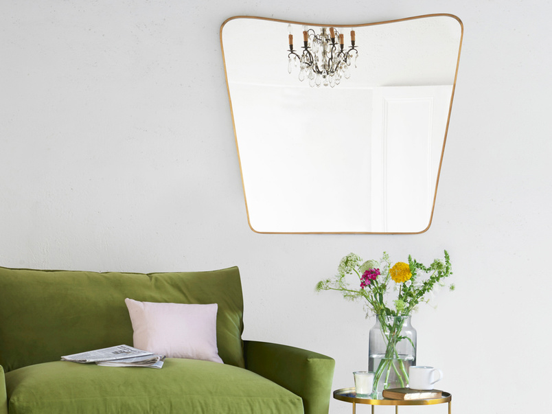 Big Brass bent and antique style brass wall mirror