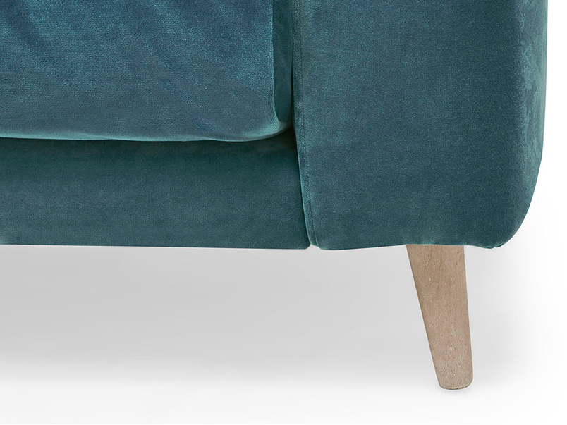 Strudel low arm upholstered armchair front leg detail