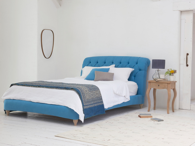 Chesterfield style beautiful upholstered Dozer bed with deep button detailing and scroll headboard