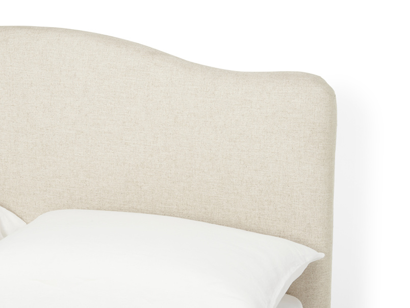 Close up detail of Luna french style bed with a curved upholstered headboard