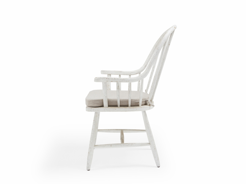White wooden farmhouse kitchen chairs with spindle back
