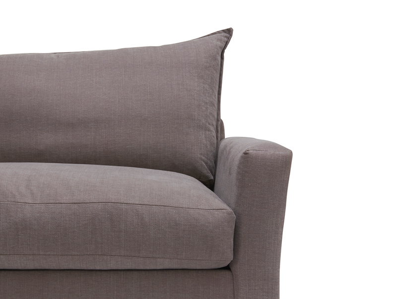 Side view of luxury comfy Pavilion Chaise corner sofa and cushions handmade in Britain