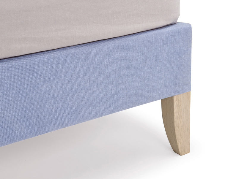 Piper upholstered contemporary bed frame and leg made from solid oak with a lovely weathered finish