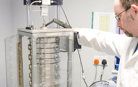 Calibration technician calibrating force sensor