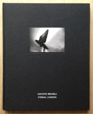The photography book cover of Eternal London by Giacomo Brunelli. In hardcover black with a pigeon.