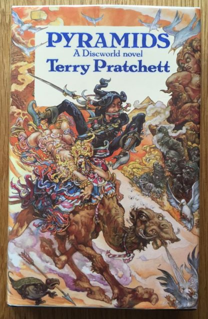 The boom cover of Pyramids: A Discworld Novel by Terry Pratchett. In dust jacketed hardcover black.