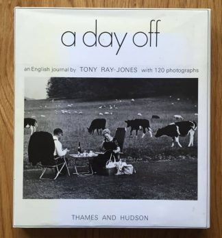 The photography book cover of A Day Off by Tony Ray-Jones. In dust jacketed hardcover mustard.