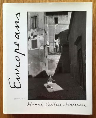 The photography book cover of Europeans by Henri Cartier-Bresson. In dust jacketed hardcover red.