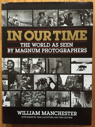 The photography book cover of In Our Time: The World as Seen by Magnum Photographers by William Manchester. In dust jacketed hardcover black.