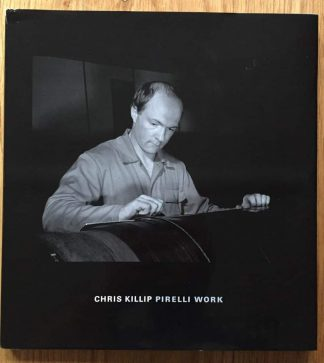 The photography book cover of Pirelli Work by Chris Killip. In hardcover grey.