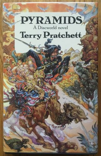 The book cover of Pyramids by Terry Pratchett. In dust jacketed hardcover black.