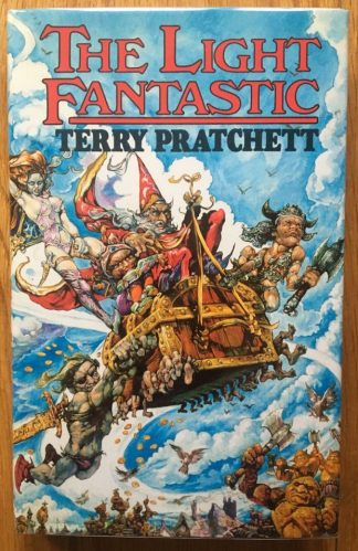 The book cover of The Light Fantastic by Terry Pratchett. In dust jacketed hardcover blue.