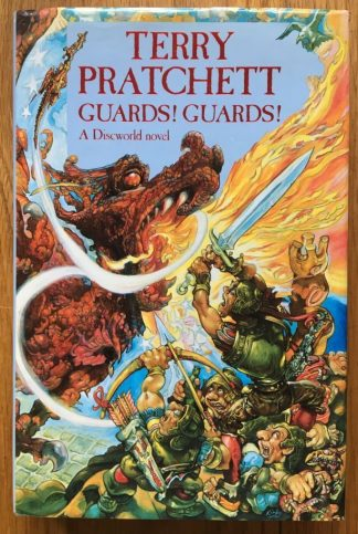 The book cover of Guards! Guards! by Terry Pratchet. In dust jacketed hardcover blue.