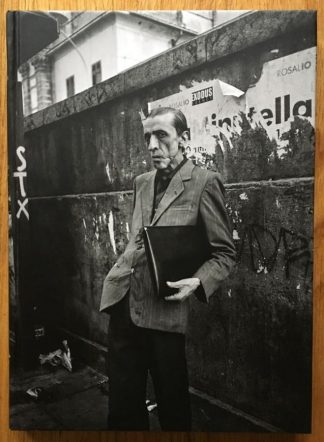 The photography book cover of Terra Nostra by Mimi Mollica. In hardcover black and white with a man in a suit.
