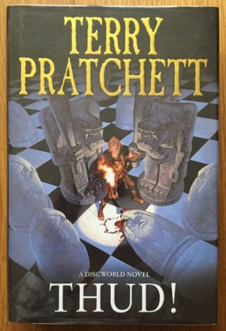 The book cover of Thud! by Terry Pratchett. In dust jacketed hardcover black.