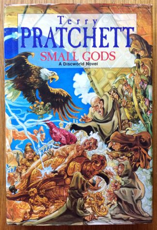 The book cover of Small Gods by Terry Pratchett. In dust jacketed hardcover brown.