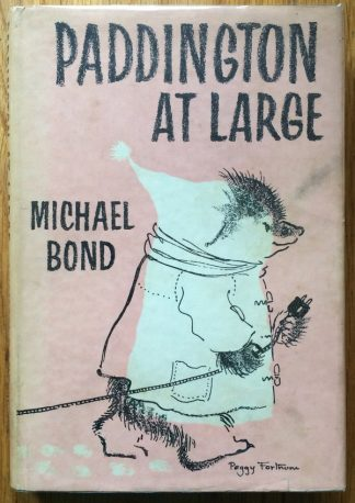 The book cover of Paddington at Large by Michael Bond. IN duts jacketed hardcover dark blue.