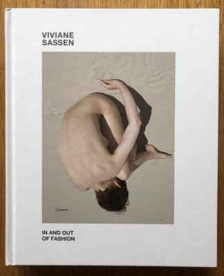 The photography book cover of In and Out of Fashion by Viviane Sassen. In hardcover white.