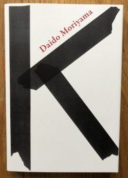 The photography book cover of K by Daido Moriyama. Paperback. White with Black K.