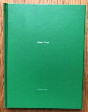 The photography book cover of Seven Dogs by John Divola. Hardback.