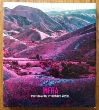 The photography book cover of Infra by Richard Mosse. In dust jacketed hardcover bright blue.