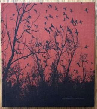 The photography book cover of She Dances on Jackson by Vanessa Winship. In hardcover black and red with trees and birds.