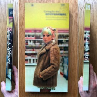 The photography book cover of Stoned in Melanchol (Cover 2) by Megan Doherty. In softcover yellow, with a young woman in a fur coat.