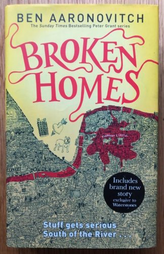 The book cover of Broken Homes by Ben Aaronovitch. In dust jacketed hardcover red.