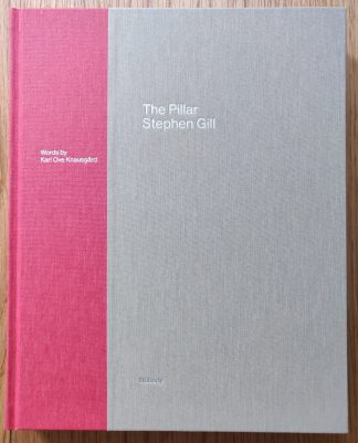 The photography book cover of The Pillar by Stephen Shore. IN hardcover grey and red.