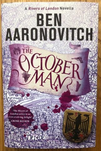 The book cover of The October Man by Ben Aaronovitch. In dust jacketed hardcover purple.