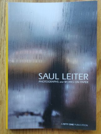 The photography book cover of Photographs and Work on Paper by Saul Leiter. In softcover yellow.