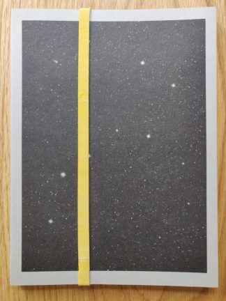 The photography book cover of Afronauts by Christina De Middel. In softcover grey and black with stars.
