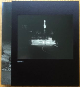 The photography book cover of Yodaka by Toshio Shibata. In slipcased hardcover black.